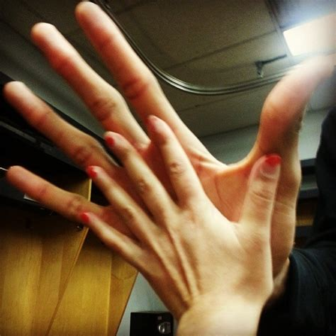 Tiny Reporter Comparing Hands With Nba Player Pics