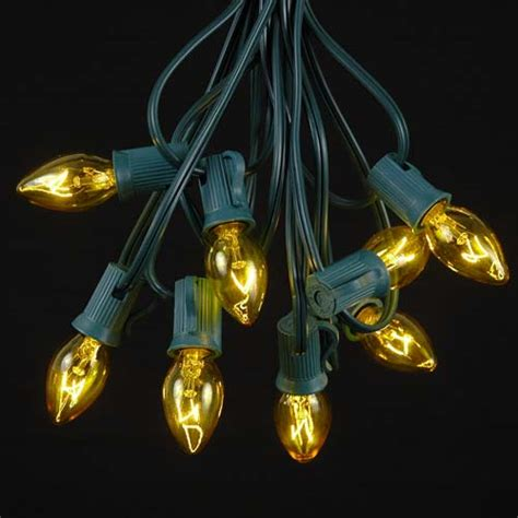 yellow transparent c7 outdoor string light set on green