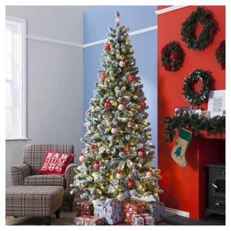 8 ft flocked slim christmas tree buy 8ft pre lit slim tree flocked emperor 350 white leds from our trees