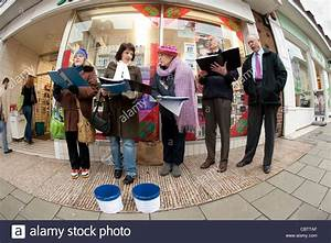 a group of Carol singers on the street collecting money ...