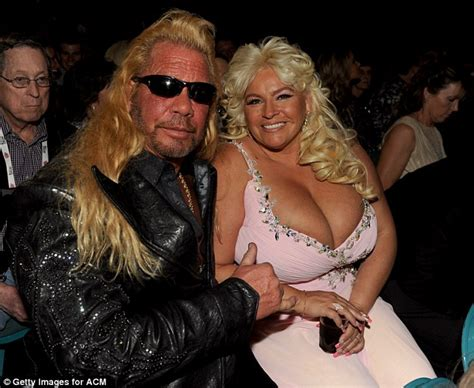 acm awards 2013 dog the bounty hunter buries his head in