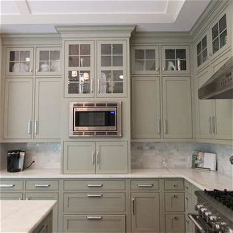 gray green cabinets transitional kitchen town