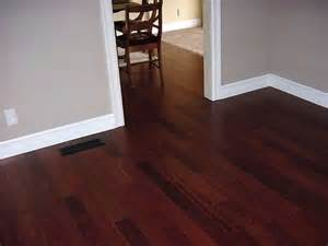 trim work with cherry floor the wall color for the home grey