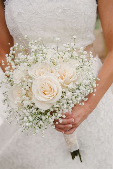 A Simple Bouquet Of Ivory Roses And Babys Breath Photo