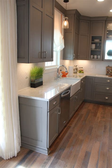 grey kitchen cabinets with grey cabinets with white marble counters love the wood