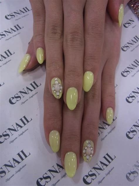 pastel yellow nails   pearl designs tho