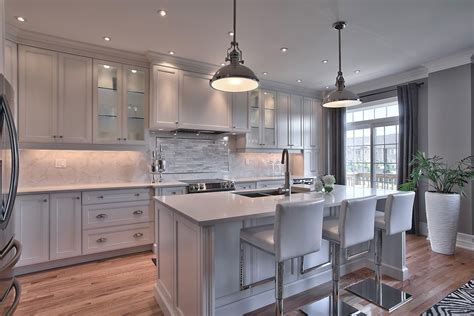 magnificent carrera marble  white kitchen remodel