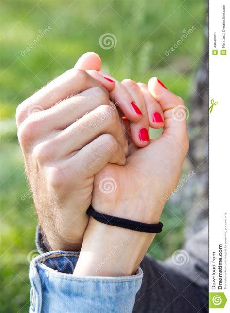 Hands Of A Couple Held Together Stock Photos - Image: 34036593