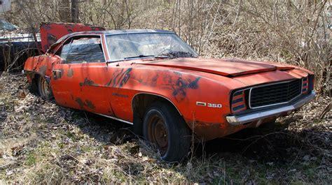 michigan junkyard turns   buried muscle car treasure