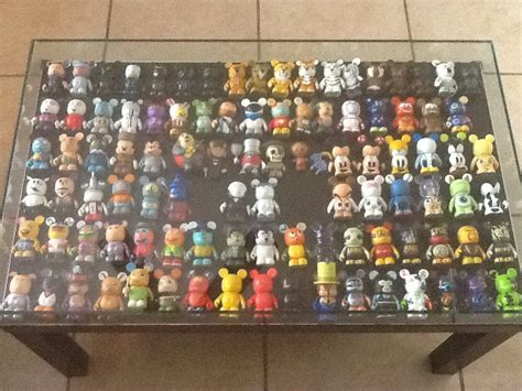 Wanna make it look like a work of a professional decorator? Vinylmation Table! I want this for my new home!! | Disney home decor