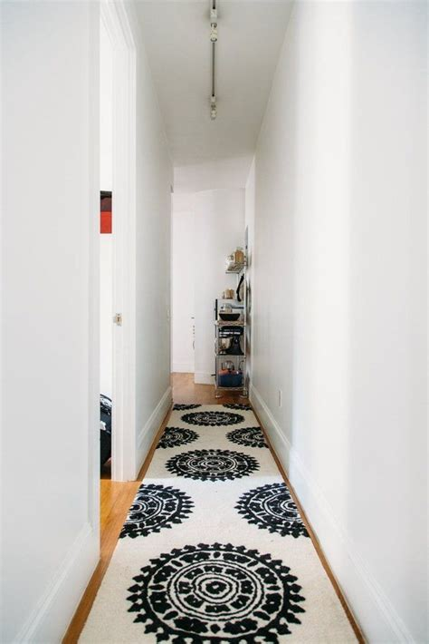 black and white hallways how you can dress up narrow spaces using hallway runners