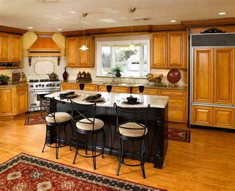 kitchen with black island maple cabinets with black island 6495