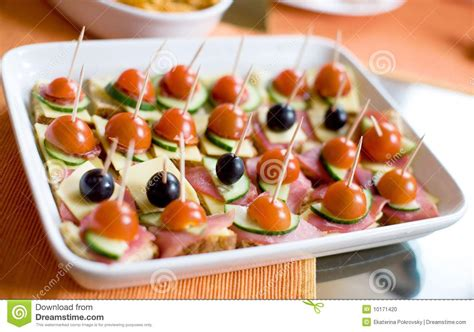 ham canapes canapes with ham cheese tomatos and olives stock photo