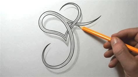 designing  stylized    heart letter tattoo