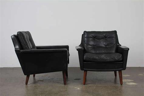 pair of black leather mid century modern lounge