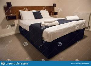 Double, Bed, With, Bedding, In, Clean, Simple, Basic, Hotel, Room, Stock, Photo