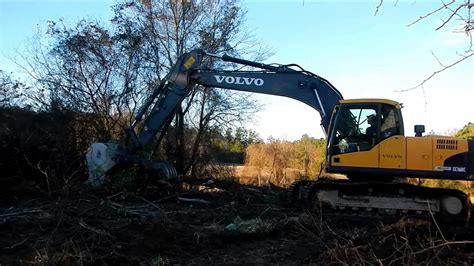 volvo cl excavator clearing land youtube