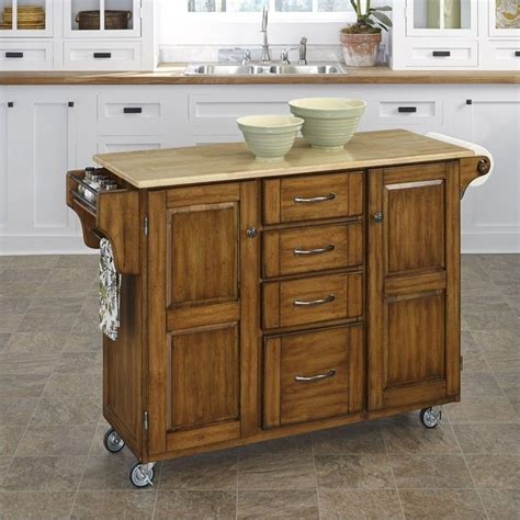 oak kitchen island cart kitchen cart in cottage oak 9100 1061 3577