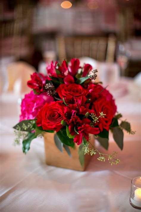 small pink  red floral centerpieces