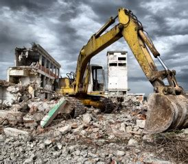 hefty asbestos removal costs delay demolitions