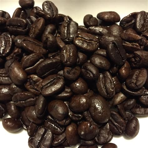 Whole beans so you can grind to how you 12 oz. Dark Roast Godfathers Dark Central American Blend Coffee Beans at Otto's Granary