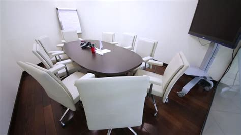 small meeting room with a table and chairs for nine