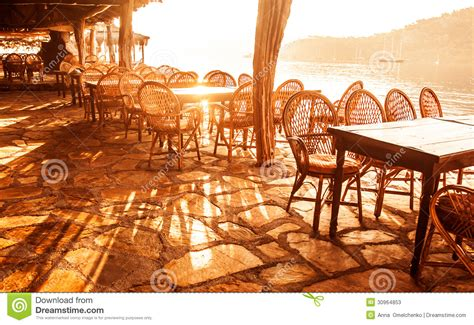 seaside cafe  sunset light stock  image