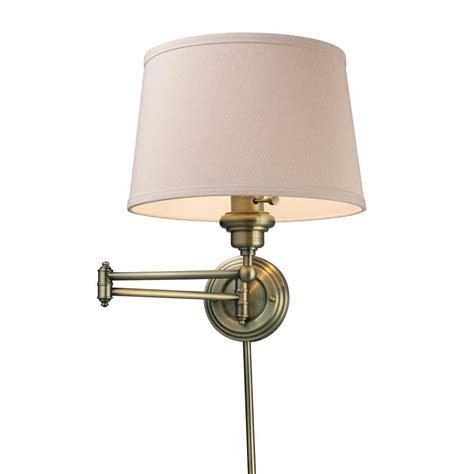 titan lighting westbrook  light antique brass swing arm