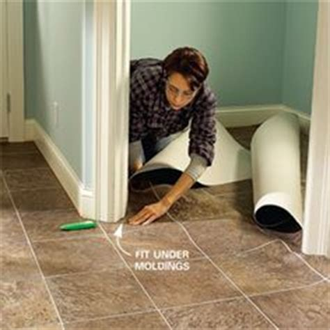 hardwood flooring in the kitchen 1000 images about vinyl flooring on vinyl 7010