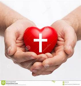 Male Hands Holding Heart With Cross Symbol Stock Photo ...