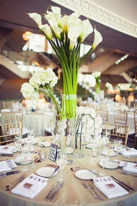 dramatic modern centerpieces filled  fresh white