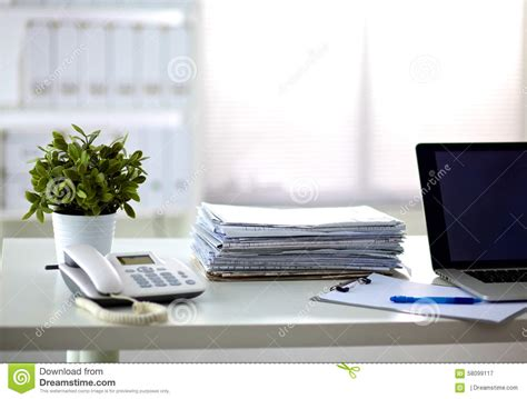 Paper On Desk by A Stack Of Papers On The Desk With A Computer Stock Image