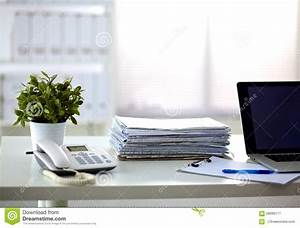 A Stack Of Papers On The Desk With A Computer Stock Image ...
