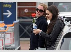 Macaulay Culkin enjoys a 'french kiss' with Mila Kunis