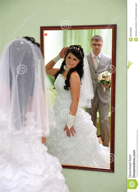 groom   bride    mirror stock photography