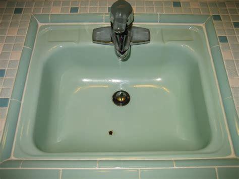 chipped  rusty porcelain bathroom sink reglaze