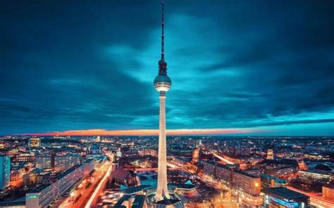 cityscape lights tower berlin clouds night germany