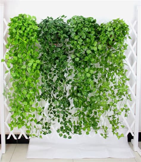 Use strong spray adhesive and artificial leaves to give a large initial a seasonal update—a great alternative to a wreath! 120cm/90cm (3pcs/lot) artificial Grape leaves wall hanging ...