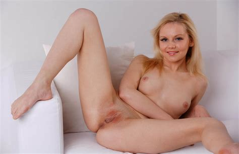 Blonde Spread Her Legs On White Sofa With A Smile
