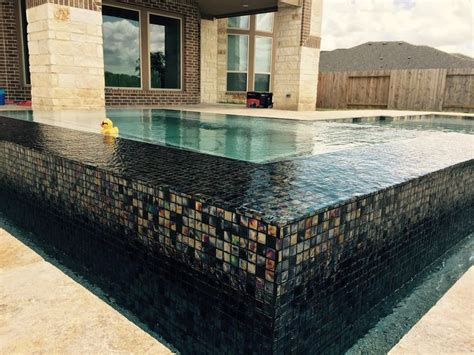 floating spas with glass tile designed by kyle franco