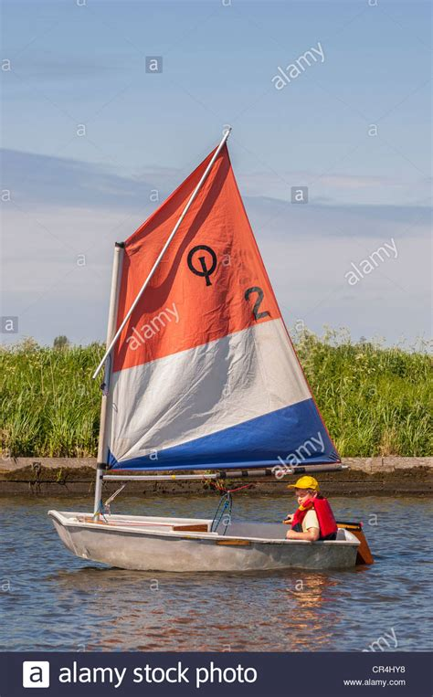 Optimist Boat by An Eight Year Boy Sailing In An Optimist Dinghy Boat