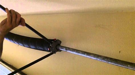 how to tighten torsion on garage door garage door torsion repair