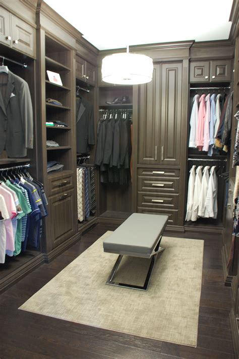 custom walk in closet with croc ottoman closet walk in