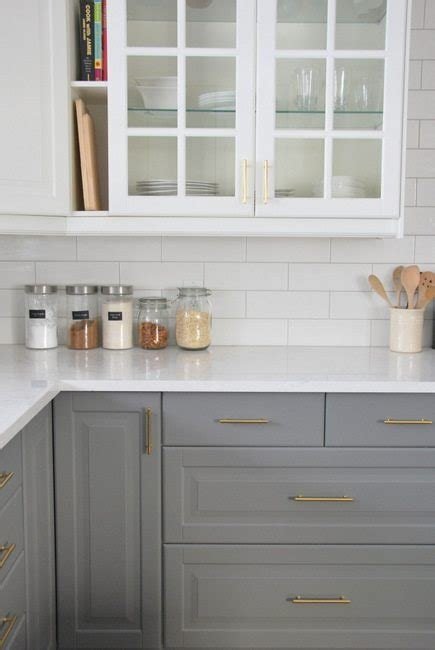 grey and white cabinets installing a subway tile backsplash in our kitchen the