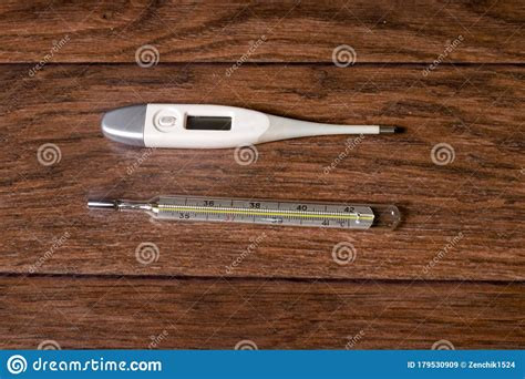 Electronic And Mercury Thermometers For Measuring ...