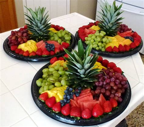 fruit ideas love the pineapple cap as the centerpiece simple to do but flashy result party ideas