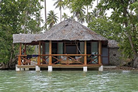 In Front Of A Bamboo Bungalow