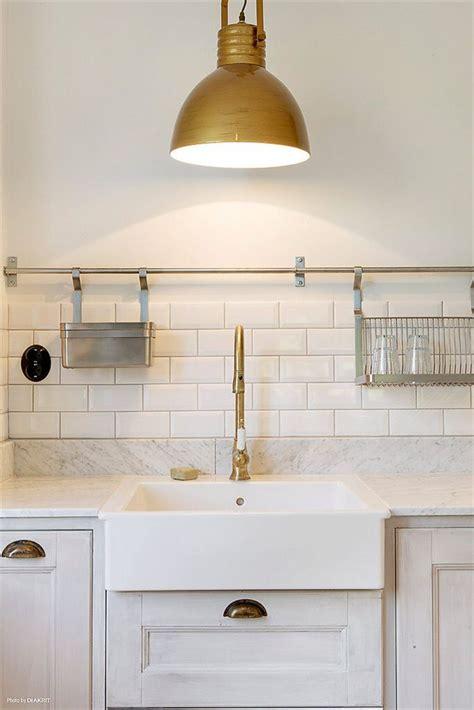brass fixtures farmhouse sink subway tiles marble