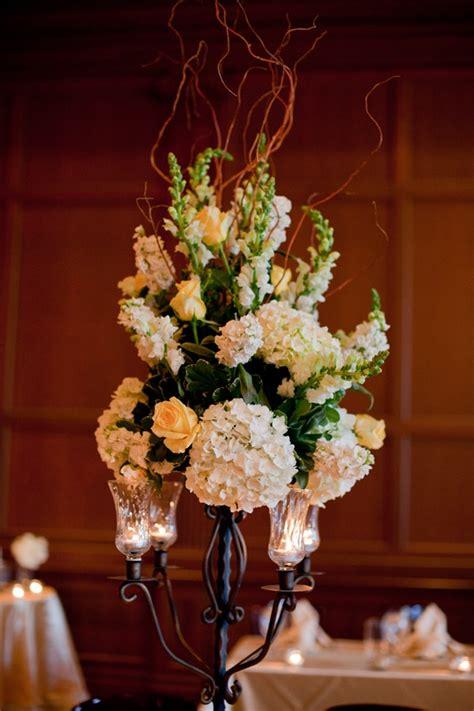 iron candelabra  sherbert orange roses white