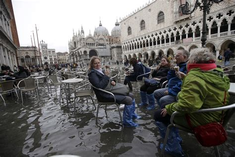 As Tourists Frolic In Venices Rising Waters Locals Fear